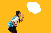 Japanese Schoolgirl Shouting At Blank Speech Bubble, Studio Shot, Mockup
