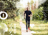 Collage with African American sportsman jogging in park and health monitoring data on imaginary screen