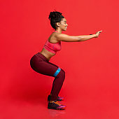 Side view of woman doing stretching work out with bands