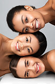 Three Diverse Girls Posing Together Smiling On Gray Background, Vertical