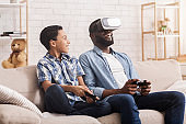 Preteen African Boy And His Dad Trying VR Set At Home