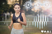 Young jogger with earphones exercising and listening to music outdoors. Collage with health info on virtual screen