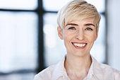 Portrait Of Happy Businesswoman Posing In Modern Office