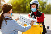 Courier Giving Pizza Boxes To Customer, Wearing Mask On Street