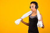 Determined Afro Woman In Headphones Standing On Yellow Background