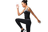 African American Fitness Girl Jumping Exercising, Studio Shot
