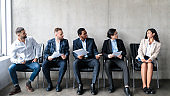 Businessmen Staring At Lady Applicant Waiting For Job Interview Indoor