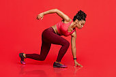 Athletic woman in steady pose, running concept