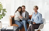 Professional Family Psychologist Sitting Next To Couple After Therapy Indoor