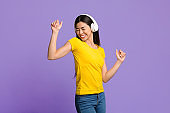 Joyful Asian Woman Listening Music And Dancing With Closed Eyes