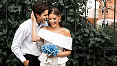 Couple On Wedding Day Hugging Having Fun Outdoor In City