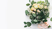 Wedding postcard for greetings, bridal bouquet of cream roses