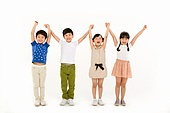 children cheering with their hands in the air