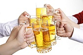 Hand holding glass beer