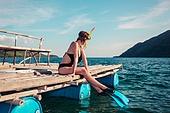 Woman in snorkeling gear on raft
