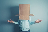 Confused man with cardboard box on his head