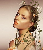 Decoration. Young Sensual Woman with Flowers