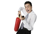 Businessman with Fire Extinguisher