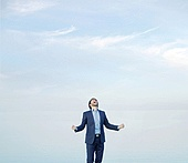 Successful man over the sky background