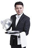 Happy waiter serving food