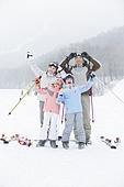 Young family skiing in ski resort