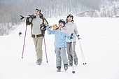 Young family skiing in ski resort