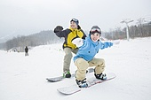 Young couple snowboarding in ski resort