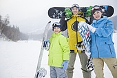 Young family with snowboards on the snow