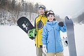 Young couple with snowboards on the snow