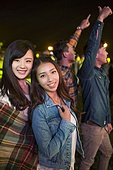 Happy young women at music festival