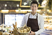 Young man working in bakery