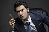 Confident businessman with cigar
