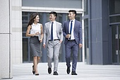 Confident business team on the move