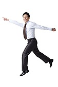 Portrait of a Businessman Jumping Up