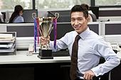 Businssman Holding A Trophy