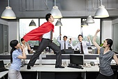 Colleagues Cheering On Superhero
