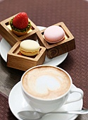 Cup of cappuccino and macaroons
