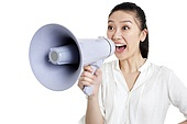 Young woman cheering through a megaphone