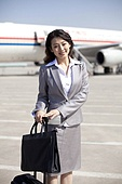 Businesswoman on the airplane runway