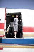 Businesswoman boarding the plane