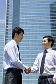 Businessman shaking hands in an urban scene