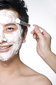 Handsome young man with facial mask