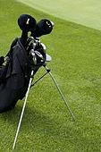 Golf Bag Beside a Putting Green