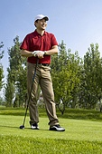 Portrait of a male golfer on the course
