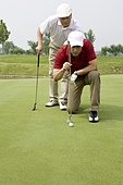 Two male Golfers on Green