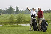 Two Golfers looking far front