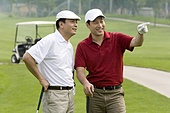 Two golfers chatting on the course