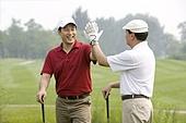 Two Golfers Celebrate a Great Shot