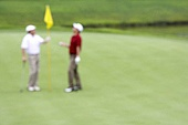 Two Golfers on the Green