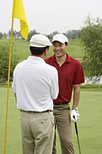 Two Golfers shaking hands on the Green